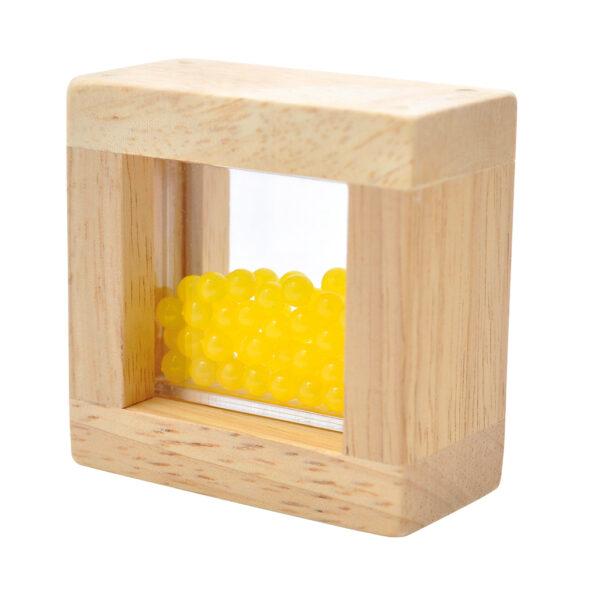 Sensorikbausteine gefüllt mit gelben Perlen
