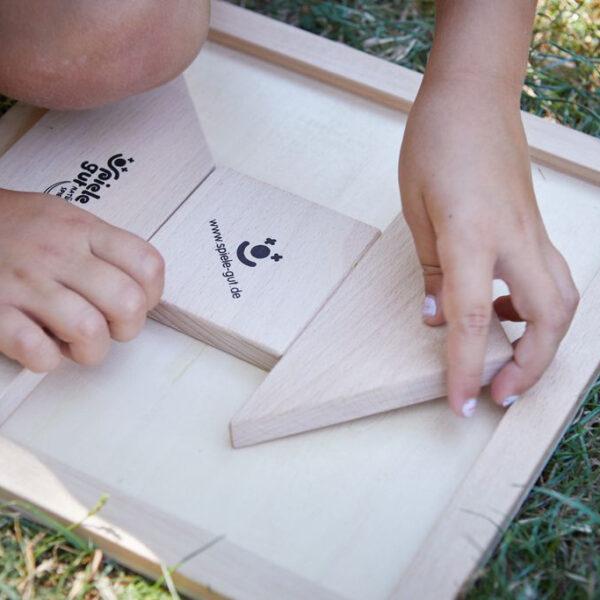 Tangalu Holzrahmen zu Tangala Konzept